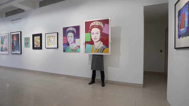 queen elizabeth ii' by andy warhol, 'red lamp' by roy lichtenstein on display during preparations taking place ahead of online sales at christie's... - currency symbol stock videos & royalty-free footage