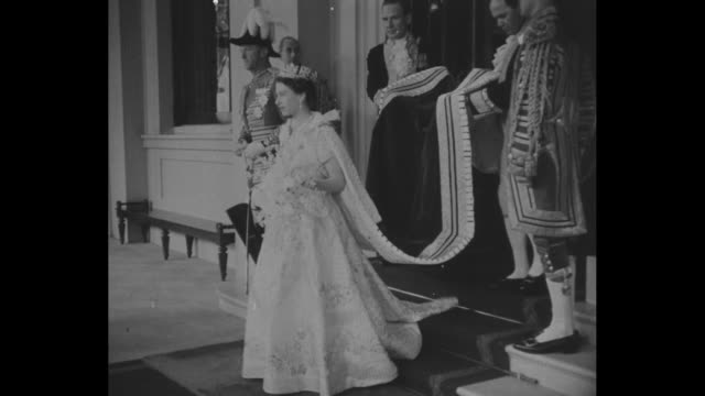 vs queen elizabeth ii carrying flowers and wearing imperial state crown leaves palace escorted by liveried footmen carrying her long train she is... - 1953 stock videos & royalty-free footage