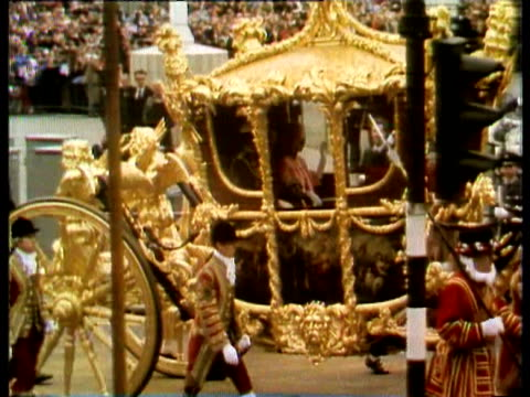 stockvideo's en b-roll-footage met queen elizabeth ii celebrates her silver jubilee anniversary the 25th year of her accession to the throne / general views and top views of coach... - 1977