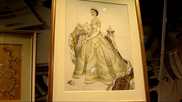 gvs and interviews visitor looking at display / close shots of coronation dress and robe / designs for coronation clothes / samples / photograph /... - folded stock videos and b-roll footage
