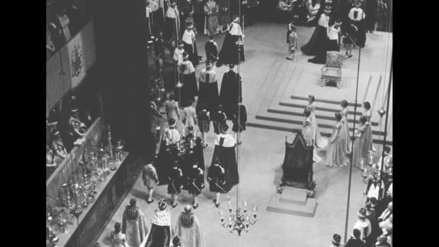 queen elizabeth ii departs westminster abbey after coronation ceremony / dean of westminster and other clergy flank the queen��s procession /... - coronation of queen elizabeth ii stock videos and b-roll footage