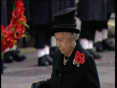 queen elizabeth ii dressed black wearing group of poppies on left shoulder lays wreath on cenotaph at remembrance day service 09 nov 03 - memorial event stock videos and b-roll footage