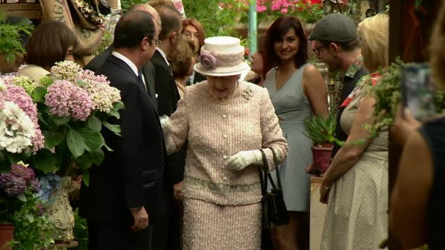 queen elizabeth ii ending three-day state visit at a parisian flower market renamed marche aux fleurs - reine elizabeth ii - françois hollande stock videos & royalty-free footage