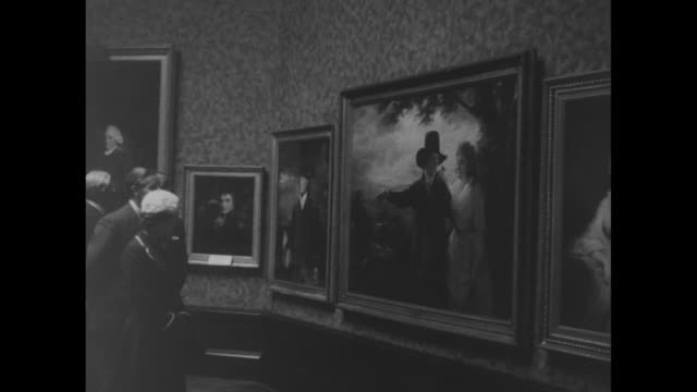 """queen elizabeth ii enters national gallery of scotland with unidentified man, past sign which reads """"loan exhibition; raeburn""""; crowd watches in... - scottish highlands stock videos & royalty-free footage"""