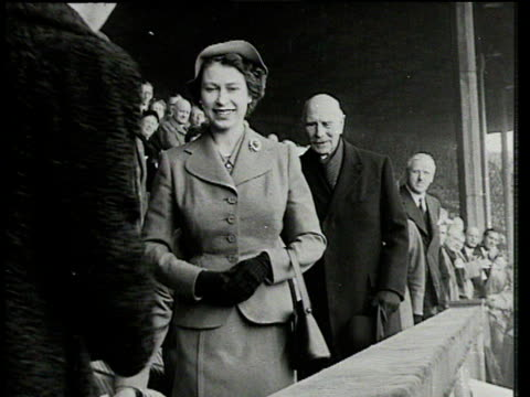 Queen Elizabeth II enters Royal box woman kisses her and curtseys Blackpool FC vs Bolton Wanderers 1953 FA Cup Final Wembley London