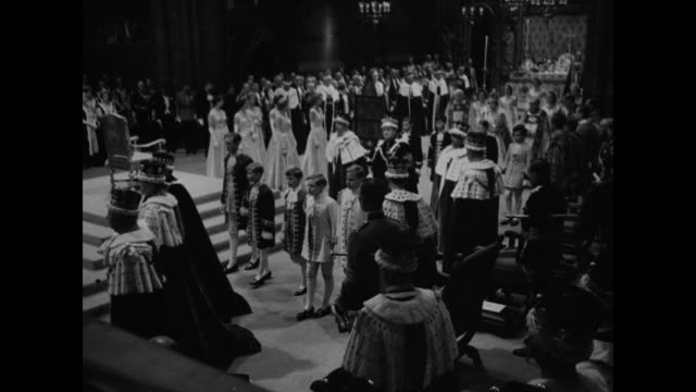 queen elizabeth ii exits coronation theater at her 1953 coronation ceremony maids of honor following / royal female peers looking on as the queen... - coronation of queen elizabeth ii stock videos and b-roll footage