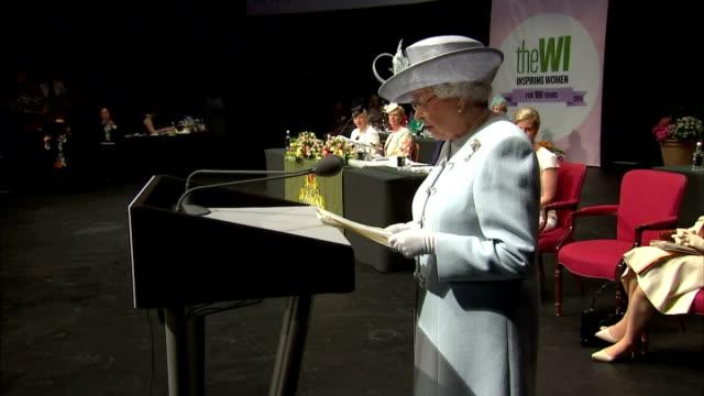 queen elizabeth ii giving speech during the women's institute annual meeting. the queen opened the centenary annual meeting of the women's institute... - 年次総会点の映像素材/bロール