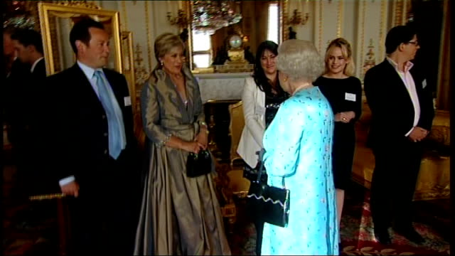 vídeos de stock, filmes e b-roll de queen elizabeth ii greeting guests at 'young people in the performing arts' reception england london buckingham palace throughout * * queen elizabeth... - ellie goulding