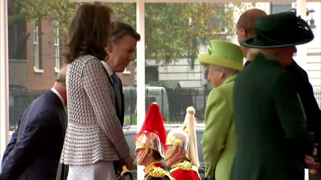 queen elizabeth ii hosted the colombian president juan manuel santos on his visit to the uk shows colombian president juan manuel santos and wife... - horse guards parade stock videos and b-roll footage