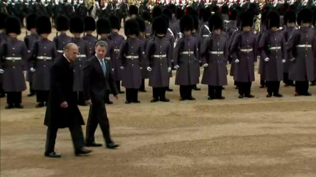 queen elizabeth ii hosted the colombian president juan manuel santos on his visit to the uk shows colombian president juan manuel santos and prince... - horse guards parade stock videos and b-roll footage