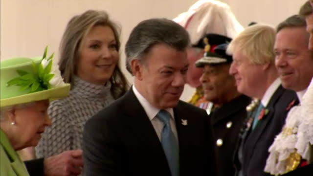 queen elizabeth ii hosted the colombian president juan manuel santos on his visit to the uk shows colombian president juan manuel santos being... - horse guards parade stock videos and b-roll footage