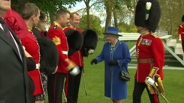 queen elizabeth ii hosts garden party for the welsh guards centenary new colours ceremony shows exterior shots the queen talking with guests in the... - elizabeth i of england stock videos & royalty-free footage