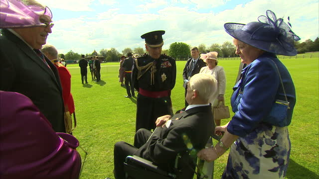 queen elizabeth ii hosts garden party for the welsh guards centenary new colours ceremony shows exterior shots prince philip speaking with guests at... - elizabeth i of england stock videos & royalty-free footage