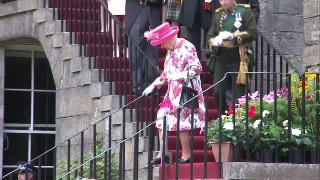 queen elizabeth ii hosts holyrood palace garden party; scotland: edinburgh: palace of holyroodhouse: ext **music heard intermittently sot ** queen... - military uniform stock videos & royalty-free footage