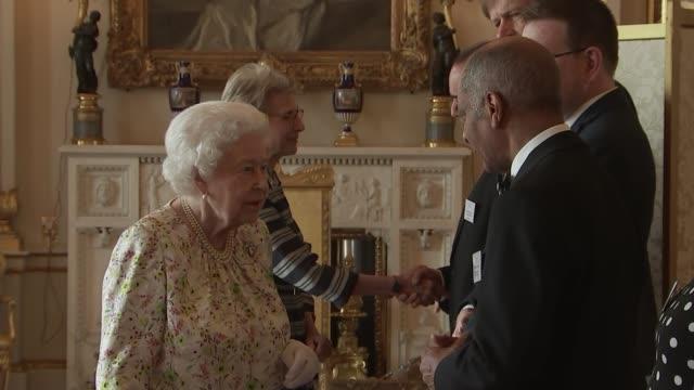 queen elizabeth ii hosts multi-faith reception at buckingham palace; england: london: buckingham palace: int queen elizabeth ii into room and... - aberystwyth stock videos & royalty-free footage