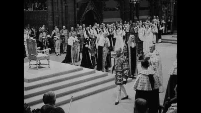 queen elizabeth ii inside the coronation theater / archbishop of canturbury peers and clergy at coronation ceremony / ms of queen elizabeth ii... - coronation of queen elizabeth ii stock videos and b-roll footage