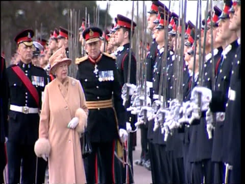 queen elizabeth ii inspects row of army cadets at their passing out parade stopping briefly to talk to prince harry royal military academy sandhurst... - passing out parade stock videos & royalty-free footage