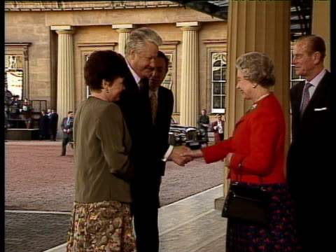 vídeos de stock, filmes e b-roll de queen elizabeth ii introduces russian president boris yeltsin and wife naya to prince andrew duke of york buckingham place 10 nov 92 - 1992