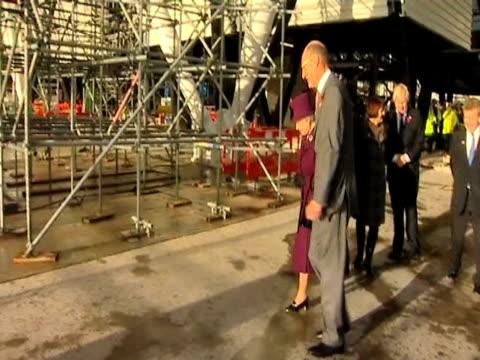 queen elizabeth ii is escorted around london 2012 olympic park construction site london 3 november 2009 - erezione video stock e b–roll