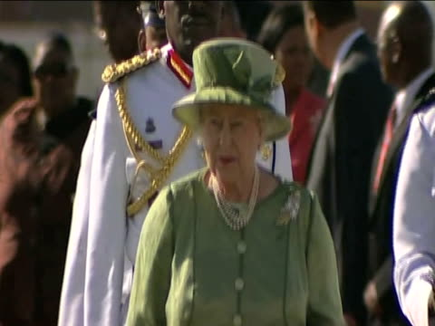 queen elizabeth ii is escorted through piarco international airport by military officers as part of her caribbean tour trinidad; 27 november 2009 - visit stock videos & royalty-free footage