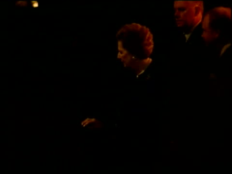 queen elizabeth ii is met by baroness thatcher on her arrival at thatcher's 80th birthday party london; 13 oct 05 - british royalty stock videos & royalty-free footage