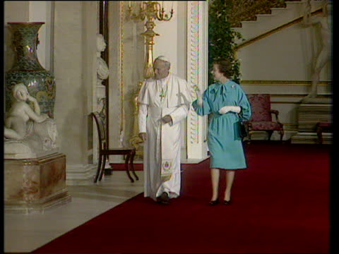queen elizabeth ii leads pope john paul ii through corridor in buckingham palace 28 may 82 - elizabeth ii stock videos & royalty-free footage