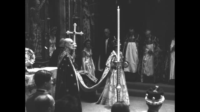 queen elizabeth ii newly crowned and carrying the sovereign's sceptre of the cross and the sovereign's orb walks in westminster abbey as... - coronation of queen elizabeth ii stock videos and b-roll footage