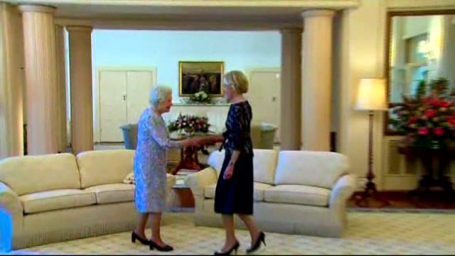 queen elizabeth ii official visit: row over protocol; queen being greeted with curtsey by australia's governor general, quentin bryce ext queen along... - british royalty stock videos & royalty-free footage
