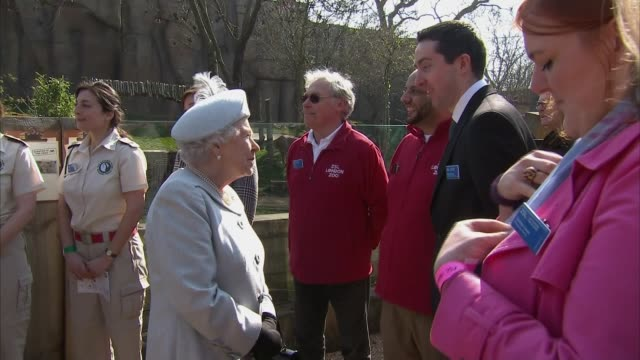 Queen Elizabeth II opens 'Land Of The Lions' exhibit at London Zoo Lions in enclosure / Queen chatting to people / Philip being presented with...