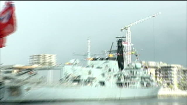 queen elizabeth ii opens new welsh assembly building; wales: cardiff: royal navy warship in harbour / sailors outside senedd building / the senedd /... - britisches militär stock-videos und b-roll-filmmaterial