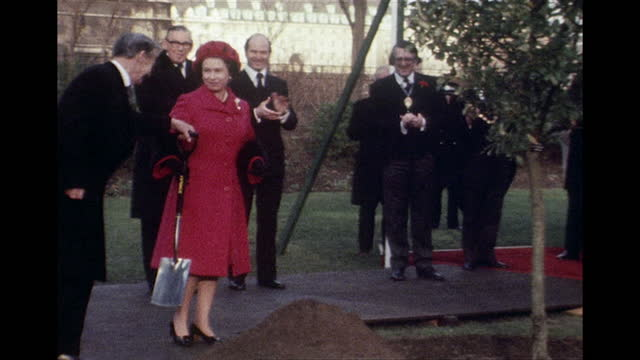 queen elizabeth ii planting a tree for her silver jubilee at victoria tower gardens, 1977 - work tool stock videos & royalty-free footage