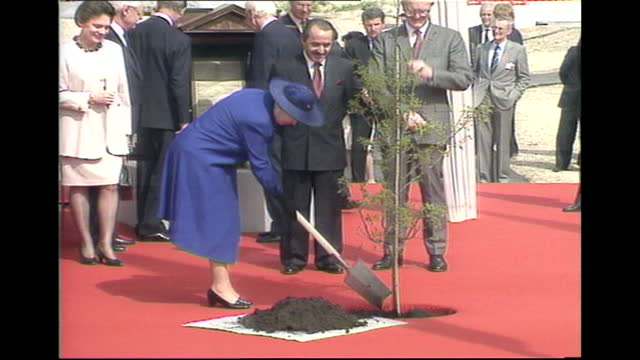 queen elizabeth ii plants tree at the european court of human rights, strasbourg, 1992 - plant stock videos & royalty-free footage