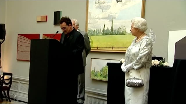 Queen Elizabeth II presents Diamond Jubilee Awards Bono onto stage to applause and speech SOT Speaks about trip made by Queen to Ireland in 2011 / on...