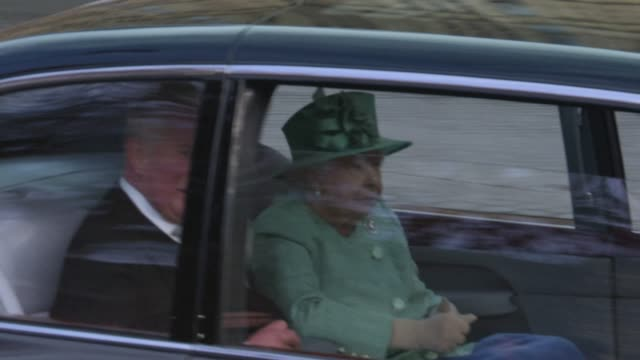 queen elizabeth ii, prince charles, prince of wales are driven in the royal bentley car arrives at the state opening of parliament on december 19,... - elizabeth ii stock videos & royalty-free footage