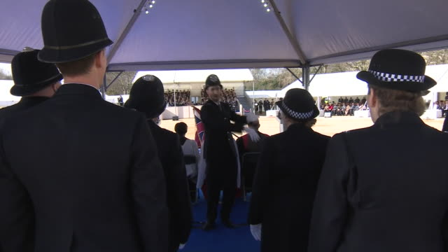 queen elizabeth ii prince philip and theresa may look on as a choir performs at the official unveiling of a monument to commemorate soldiers killed... - launch event stock videos & royalty-free footage