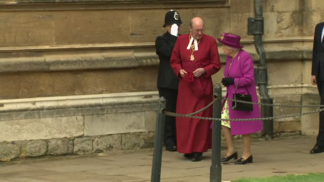 queen elizabeth ii prince william and catherine duchess of cambridge leaving st george's chapel in windsor after easter service - st. george's chapel stock videos and b-roll footage