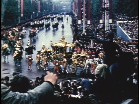 queen elizabeth ii rides in a horse drawn carriage during her coronation procession. - colour image stock videos & royalty-free footage