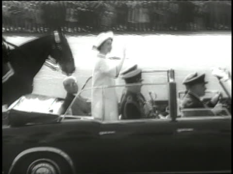 queen elizabeth ii rides in a motorcade through the streets of rome as spectators cheer. - elizabeth ii stock videos & royalty-free footage