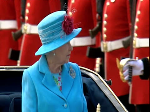 queen elizabeth ii rides past line of footguards in horse drawn carriage during trooping the colour parade london 13 june 2009 - carriage stock videos and b-roll footage