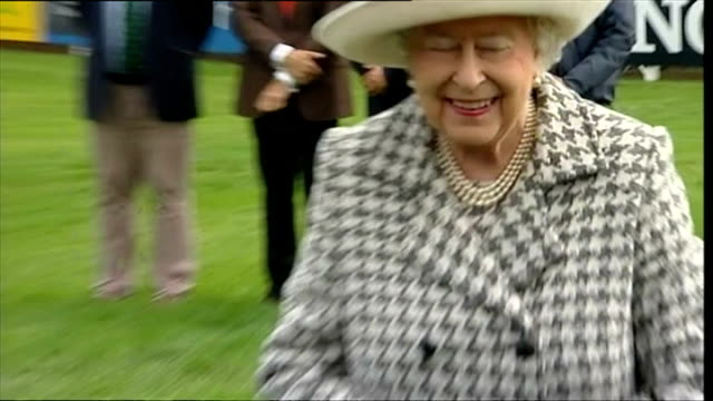 queen elizabeth ii rounds off historic week with trip to perthshire horse show shows exterior shots of a smiling queen elizabeth ii awarding silver... - perthshire stock videos & royalty-free footage