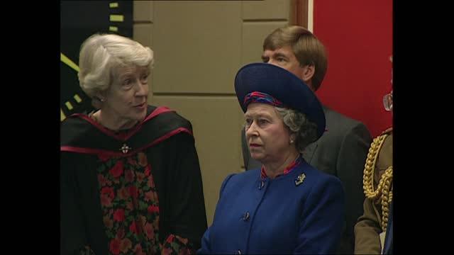 queen elizabeth ii school visit; england: london: barbican: city of london school for girls: int cs queen elizabeth ii in navy hat and suit smiling;... - puppet stock videos & royalty-free footage