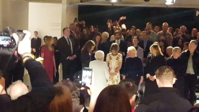 queen elizabeth ii sits next to anna wintour as they view richard quinn's runway show before presenting him with the inaugural queen elizabeth ii... - königin stock-videos und b-roll-filmmaterial