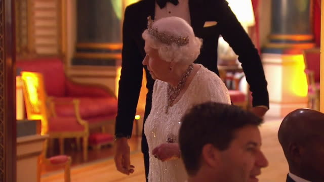 queen elizabeth ii sitting down for dinner before the commonwealth head of government's meeting at buckingham palace - british empire stock videos & royalty-free footage