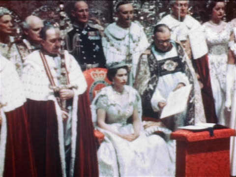 queen elizabeth ii sitting in chair surrounded by clergy at coronation ceremony / documentary - elizabeth ii stock videos & royalty-free footage