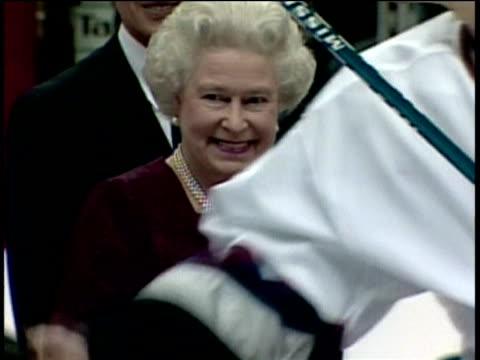 queen elizabeth ii smiling as audience applaud her at ice hockey match during golden jubilee tour of canada 07 oct 02 - golden jubilee stock videos & royalty-free footage