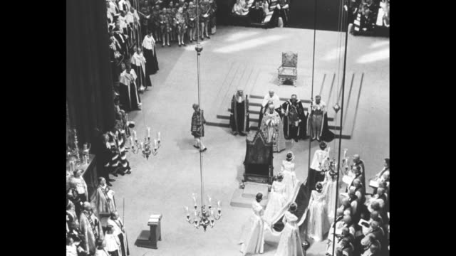 queen elizabeth ii standing in front of chair of estate kneels down on kneeler / dean of westminster stands in front of altar / cu crown of st edward... - 1953 stock videos & royalty-free footage