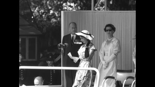 queen elizabeth ii stands in summer dress and hat with prince henry, duke of gloucester, and princess marina, duchess of kent, behind her at outdoor... - prosperity stock videos & royalty-free footage