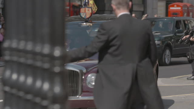 hrh queen elizabeth ii the duke of edinburgh attend a service to mark the centenary of the order of the british empire at st paul's cathedral on may... - order of the british empire stock videos and b-roll footage