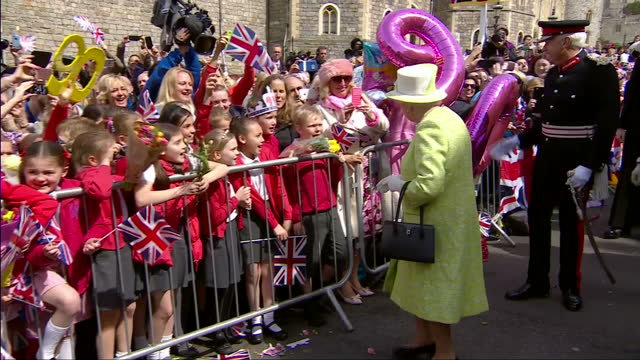 queen elizabeth ii today celebrated her 90th birthday. on her birthday walkabout of windsor, she was treated to multiple renditions of 'happy... - 90th birthday stock videos & royalty-free footage