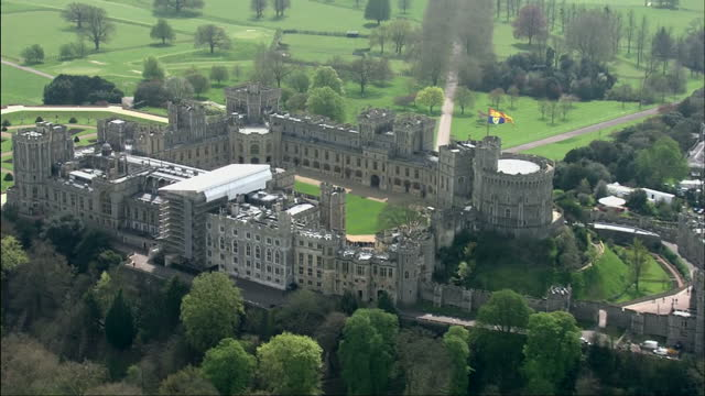 queen elizabeth ii today celebrated her 90th birthday shows aerials of windsor castle and crowds visible lining street outside gates - windsor england stock videos & royalty-free footage